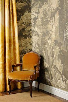 'Le Eden' design in Terre Fonce design colours on Terre Fonce scenic paper. 'Le Eden' design in custom monochromatic design colours on wartery sunshine Organza fabric. de Gournay Louis XV Fauteuil a la Reine chair upholstered in Honey silk velvet fabric.