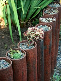 Metal pipes can serve as a robust and protective edging option for your garden. They also can serve as another area for you to plant in! Whether you fill the pipes with dirt, rocks, tiny cacti, or other tiny plants, anything you add to these pipes will take away from the tough look of the pipes and provide your garden a new look without sacrificing practicality.