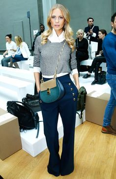 Poppy Delevingne went for a cool polished '70s vibe in a layered blouse and flared jeans at the Chloé F/W 15 Show at Paris Fashion Week