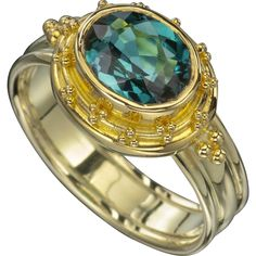 1.81 Ct Indicolite Tourmaline 18 Karat and 22 Karat Yellow Gold Ring. 9 x 7 mm Oval faceted Indicolite Tourmaline. New custom made one-of-a-kind Ring