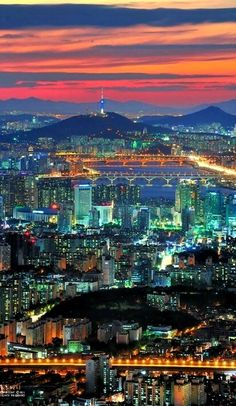 Seoul City - The colors in this photo are so dynamic and complex. The warm and cool colors looking like they're dancing throughout the picture. Where are your favorite places to take pictures in Seoul (You Are My Favorite Bucket Lists)