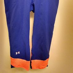 Under Armour Heat Gear crops Heat Gear crops. Compression fit per UA. Lightweight. Made of polyester and Elastane. Blue and orange accents. Never worn. They are too small. I needed a medium, but never tried on until it was too late. Have another pair that Iove. Under Armour Other