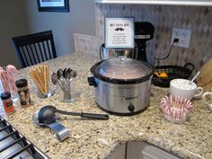 Hot cocoa bar with hot cocoa in a crockpot! Genius!!! I'm going to do this for the kids :)