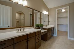 Master en suit bath, walk in closet. Dark stained wood cabinets. Bronze hardware. Vaulted ceilings. Ceramic tile floors.