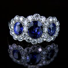 Triple sapphire and diamond cluster engagement ring