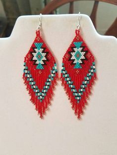 Beautiful Native American Style Beaded Rug Earrings in Black, White, Red and Turquoise and Copper. They are 4 inch long and 1 inch wide. If you like these but would like other Colors just email me.Thanks for looking.