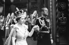 Queen Elizabeth II and the Duke of Edinburgh pass in procession through the House of Lords after the State opening of Parliament.