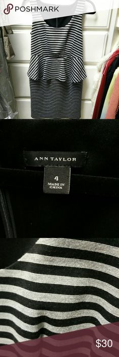Ann Taylor Peplum Dress Super cute. Peplum dress. Perfect for work Black and gray stripes with detailed fabric. Somewhat stretchy and comfortable. Great quality Ann Taylor material. Slit in the back bottom. And zipper int he back Great condition except for a little wear/slight pilling Ann Taylor Dresses Midi