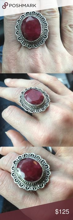 Huge Natural Ruby and Sterling Silver Ring size 7 Gigantic natural ruby in a lovely ornate sterling silver setting. Size is 7.5. This ring is absolutely gorgeous in person. The light really dances as it bounces off the facets. Stamped 925 Jewelry Rings