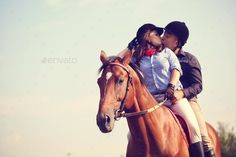 Couple riding a horse by AndreiAlex. Couple riding a horse
