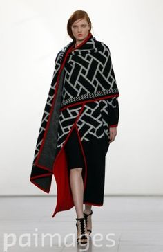 Issa's graphic cape is noteworthy, least for the colours but also the dramatic silhouette it creates.