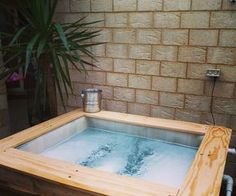 Building a small above ground pool/spa using a 1000L IBC and some pallets