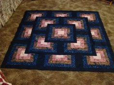 """""""Outside the box"""" quilt. I would change the colors, but the pattern is great."""