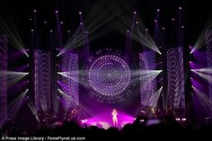 Impressive: The stage was lit-up in purple shades as the superstar worked her magic