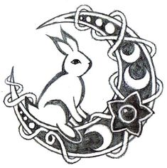 A tattoo of a rabbit sitting on the Moon. Small tattoo design for girls.
