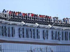 Best of the 2016 Daytona 500:     Spotters work from the roof of the press box.