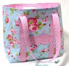 This handmade cotton tote bag is made with a delicate floral fabric with coordinating dotty lining and straps. Along with the pocket on the front, there is an internal zipped pocket. The bag, measuring approx 19