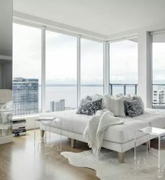 Seattle, Washington Designer Christian Grevstad created a modern, white interior in this Seattle high-rise condo. A roundabout lounge area takes advantage of miles of views. A custom piece by Grevstad, it's covered in a durable Perennials outdoor textile. Luxury Condo, Luxury Apartments, Luxury Penthouse, Luxury Homes, White Apartment, Condo Design, Piece A Vivre, Condo Living, Living Rooms