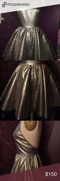 Metallic Silver Alice & Olivia size 2 NWT Dress NEW WITH TAGS SIZE 2 Alice and Olivia metallic party dress. Racervscj back with zip up the back. Size 2. Alice + Olivia Dresses Prom