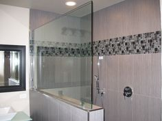 """Our new Master Bath... Walk in shower with built-in seat, dual drains, mini pebble shower floor and two shower heads. """"Floating Vanity"""" with white Porcelain Vessel Sinks and Frameless 1/2 inch Glass complete the bathroom. Thank you Team Tile and Stone, Las Vegas! teamtileandstone...."""