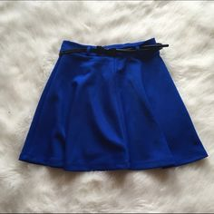 Blue Skirt with Black Leather Bow Belt Brand new and never worn! Not a flaw on this! Adorable blue skirt with a black bow belt. Very stretchy fabric. NO TRADES PLEASE Forever 21 Skirts