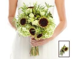 Green sunflowers with wild white and green flowers. Would be a lovely bridal bouquet and we can add succulents too. A variation of this could be put into mason jars for the centerpieces.