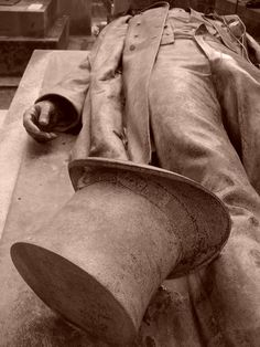 Victor Noir grave, in Pere Lachaise Cemetery in Paris.   made in 1804 by Artist Jules Dalou.   The sculpture has a very noticeable bulge in Noir's trousers. This has made it one of the most popular memorials for women to visit in the famous cemetery. Myth says that placing a flower in the upturned top hat after kissing the statue on the lips and rubbing its genital area will enhance fertility, bring a blissful sex life, or, in some versions, a husband within the year.