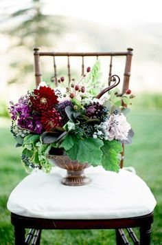 Loose garden arrangement with burgundy and touches of blue. No purple.