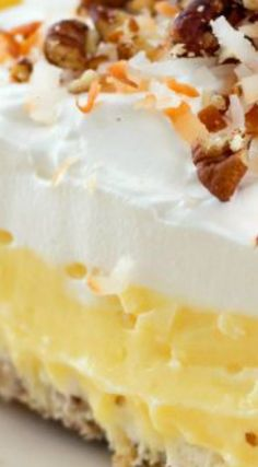 Coconut Cream Lush ~ Begins with a pecan shortbread crust, next a whipped cream cheese layer, then a thick layer of coconut cream custard.  The top is frosted with billows of whipped cream and it's finished with a sprinkle of toasted coconut and chopped pecans