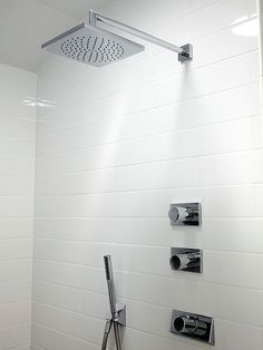 Pamper yourself and give your shower a luxury spa feel by switching out the old showerhead for a large rain-style showerhead. Many affordable models are readily available from home centers and thread easily onto existing plumbing.