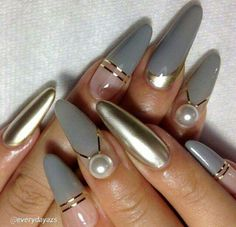 Niice stilleto nails and the color and design are dope!!