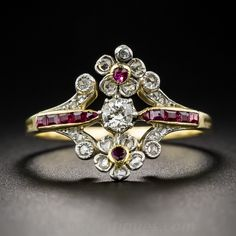 Edwardian Diamond and Ruby Ring. Early twentieth-century Edwardian jewels don't come any sweeter than this dainty delight. Lovingly hand-fabricated in platinum and 18K yellow gold, this fanciful feminine treasure centers on a sparkling European-cut diamond embraced north and south by a pair of glittering rose-cut diamond, ruby-centered blossoms. The trifoliate shoulders are adorned with a slender row of calibre-cut rubies set between rose-cut diamond wisps