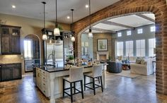 Open concept with beams and brick wall. #openconcept #greatrooms homechanneltv.com
