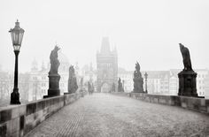 Guardians of eternity - Morning on Charles bridge, Prague. It's quite difficult to find this bridge empty (almost) of people. I had to come back 3 times, twice after midnight and once before 8 pm, to catch this one. But it's worth the effort. This bridge and its backdrop behind is so magical and fairy.