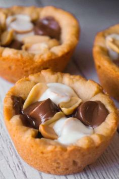Caramel Peanut Butter Cookie Cups are an easy peanut butter dessert recipe. These cookie cups are filled with caramels, mini peanut butter cups, white chocolate peanut butter cups and roasted peanuts. Mini Desserts, Cookie Desserts, Christmas Desserts, Christmas Baking, Easy Desserts, Cookie Recipes, Delicious Desserts, Dessert Recipes, Yummy Food