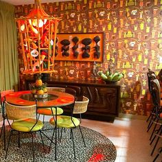"""Palm Springs, my pad. Art by Birdcage lamp and wall paper by me. Table and chairs by Arthur Umanoff. """"Witco Oceanic"""" credenza by Lane. I'm gonna abandon art to become an interior decorator. Who wants to be my first client? Birdcage Lamp, Tiki Art, Tiki Tiki, Interior Columns, Interior Architecture, Tiki Bar Decor, Tiki Lounge, Vintage Tiki, Tiki Room"""