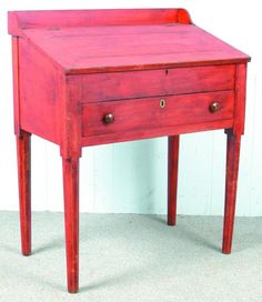 """Pennsylvania Country Sheraton Softwood Slant Lid School Master's Desk with old red paint. Dovetailed gallery, pegged construction, hinged lid with interior compartment, full-width dovetailed drawer and tapered pencil-post legs. 43""""h x 35""""w x 21 ½""""d. Condition: Missing lock and distressed surface."""
