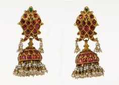 A pair of gold traditional ear pendants, set with rubies, emeralds and diamonds, suspended are pearls. Provenance: South India, Tamil Nadu 19th century.