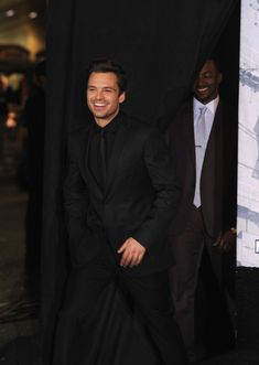Killing us with that adorable smile. | 21 Time Sebastian Stan Was Too Damn Hot (PS love Mackie in the background)