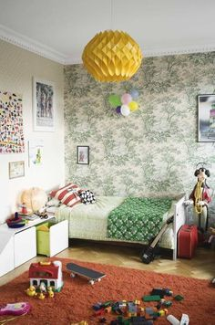 This gender-neural room is home to boys, but would be a great place for girls too. The bed pushed into the corner makes more room to play.