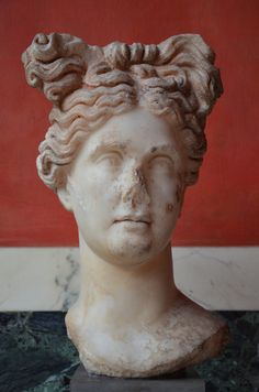 Colossal marble head of a woman or goddess from Aphrodisias (Hadrianic baths complex) in Asia Minor showing extensive remains of original colour on both hair and skin, 2 century AD, Ny Carlsberg Glyptotek, Copenhagen.  by Following Hadrian, Flick