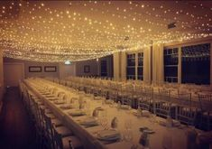 fairytale weddings are made of - a canopy of fairy lights covered ceiling . fairytale weddings are made of - a canopy of fairy lights covered ceiling . Romantic amber lighting designs at this falling Roses-themed wedding with (Venue: Wedding Lighting Indoor, Indoor Wedding Receptions, Wedding Reception Lighting, Diy Outdoor Weddings, Wedding Reception Decorations, Wedding Ideas, Reception Ideas, Outdoor Lighting, Wedding Photos