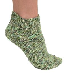 Follow this free knit pattern to create this pair of ankle socks using On Your Toes Bamboo Sock yarn.