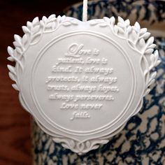 Olive branches of peace are woven around the words: Love is patient, love is kind. It always protects, always trusts, always hopes, always perseveres. Love never fails. From the famous love chapter 1 Corinthians 13, these words touch our hearts deeply and inspire us to persevere in love and never give up. This heart is especially designed for weddings, anniversaries and for love gifts of all kinds like saying thank you on Valentines or Mother