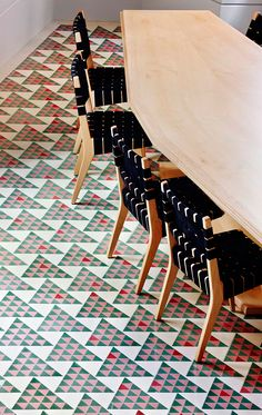 The specially made tiled floor references a triangular public square nearby with a tessellated pattern progressively graduating with 25 colors