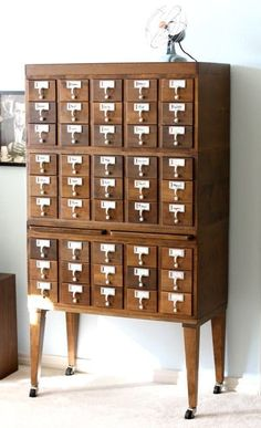 I recently had to sell my business's beloved card catalog (we displayed greeting cards in it — surprise!) because there won't be room for it in our new studio. It went to a very good home, but since then, I have done nothing but dream about card catalogs and everything that I could do with one, especially with all of this fun organizing talk going around! The possibilities are endless, but I found a favorite use that feels homey, practical and lovely all at once.