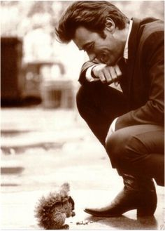 Clint Eastwood feeding a squirrel