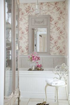 Beautiful bathroom with French armoire and beautiful mirror