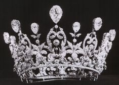 The high belle epoque diamond tiara, circa 1890s, by Boucheron, made for Consuelo Vanderbilt when she married the Duke of Marlborough. Designed as a circlet, with foliate scrolling motifs and smaller spacers, everyone of them topped with a large pear-shaped diamond.