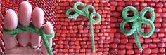 Shamrocks from pipe cleaners. I am so doing this.  Might add a safety pin for kids who don't wear green.